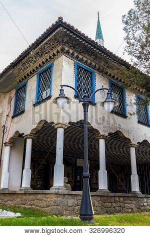 Bayrakli Mosque Or Yokush Mosque In Samokov, Bulgaria, Exterior Partial View With A Street Lamp