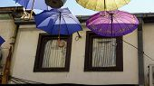 colorful umbrellas in the old town of skopje poster