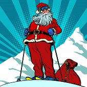 Skier in the mountains Santa Claus character merry Christmas and happy new year. Pop art retro vector illustration vintage kitsch drawing 50s 60s poster