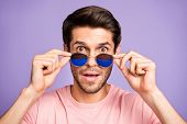 Close-up portrait of his he nice attractive cute cool amazed bearded brunet guy wearing pink tshirt putting specs of emotion expression isolated on violet purple lilac pastel color background poster