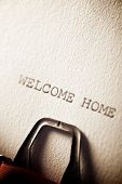 The sentence, Welcome Home, written with a typewriter. poster