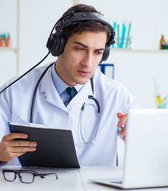 Male doctor listening to patient during telemedicine session