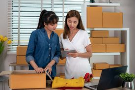 Two Asian Teenager Owner Business Woman Work At Home For Online Shopping, Checking Order  For Delive