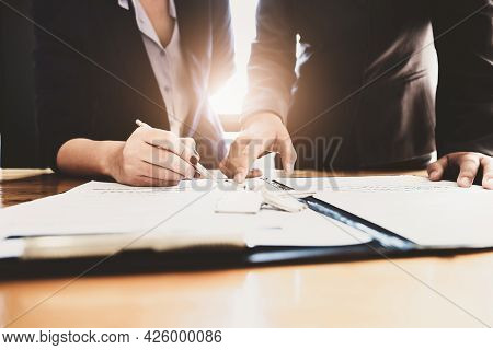 Estate Agent Gives Pen And Documents Agreement With Customer To Sign Contract. Concept Agreement.