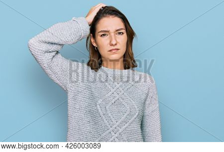 Young caucasian girl wearing casual clothes confuse and wonder about question. uncertain with doubt, thinking with hand on head. pensive concept.