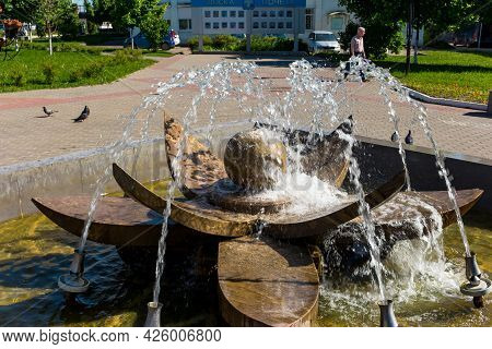 A Stone Fountain In The Shape Of A Flower In The Central City Square: Balabanovo, Russia - June 2021