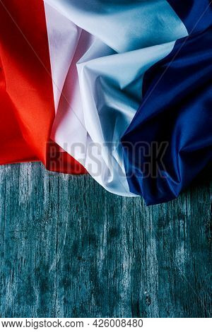 closeup of a french of flag on a gray rustic wooden background