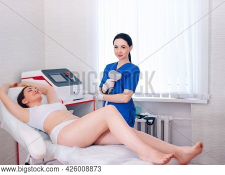 A Black-haired Beautiful Cosmetologist Girl Does Laser Body Hair Removal, A Businesswoman In White U