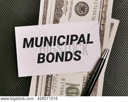 Business And Finance Concept. Phrase Municipal Bonds Written On White Card With Pen And Fake Money.