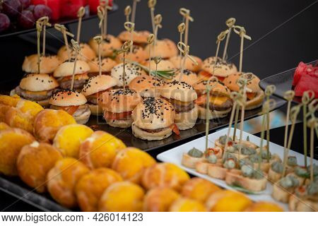 Mini Burgers With Black Sesame Seeds At The Buffet Table.