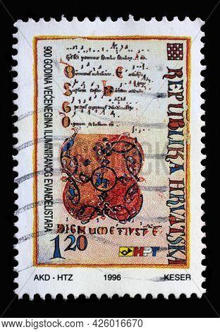 ZAGREB, CROATIA - AUGUST 29, 2014: A stamp printed in Croatia shows 900 years of Vekenegas illuminated Book of Gospels, circa 1996