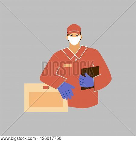 Courier In A Red Uniform And A Face Mask With A Box In His Hands. Delivery Man Of Goods During The P