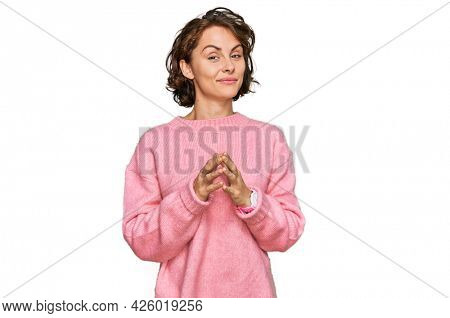 Young hispanic woman wearing casual clothes hands together and fingers crossed smiling relaxed and cheerful. success and optimistic