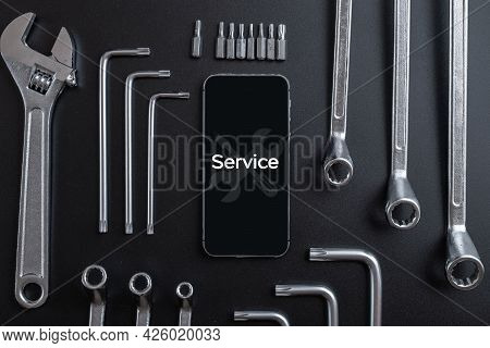 Phone Repair Technician. Technician Workplace With Phone And Special Repairing Tools. Computer Hardw