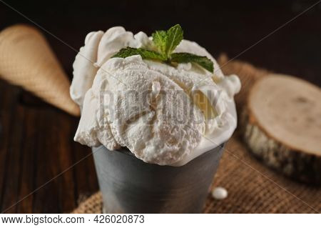 Creamy Ice Cream In Bucket On Wooden Background And Burlap In Rustic Style
