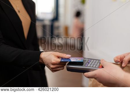 Close Up Of Businesswoman Holding Plastic Credit Card In Hand, Paying For Food Delivery In Company O