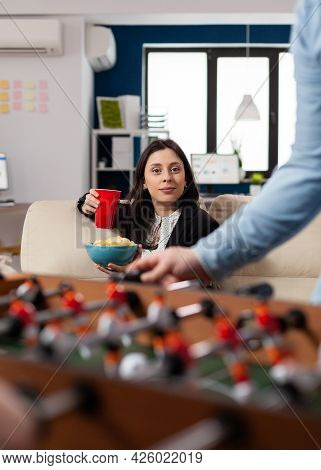 Caucasian Woman Holding Cup Of Beer And Chips After Work Looking At Foosball Table Soccer Game Footb