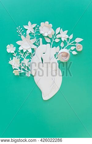 Human Heart Organ Concept With Paper Flowers As A Circulatory Anatomy Made Of Paper As A Medical Hea