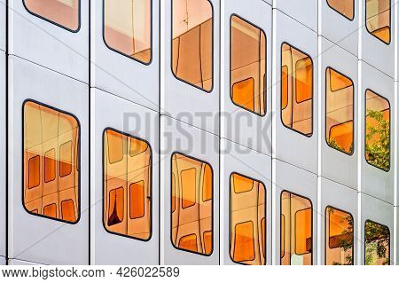 Orange Windows On Wall. Abstract Colorful Backgrounds. Cityscape.