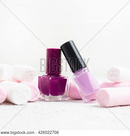 A Bottle Of Nail Polish And Marshmallows . The Concept Of Nail Polish Without Inscriptions. An Artic