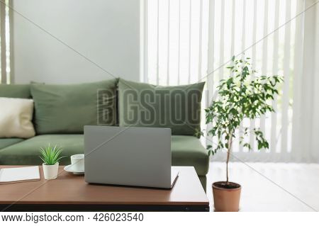 Work From Home, Workspace, Desktop, Remote Work Concept, Gray Thin Laptop Computer On Brown Wooden T