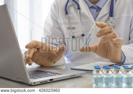 Cropped Photo Of A Doctor Talks About The Newest Vaccine During An Online Video Call. He Talks About