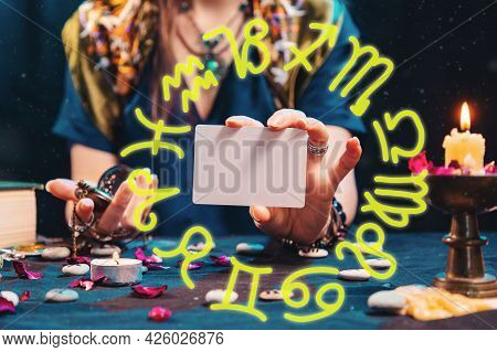 Divination And Astrology. The Fortune Teller Shows An Empty White Tarot Card. Zodiac Circle.mock Up.