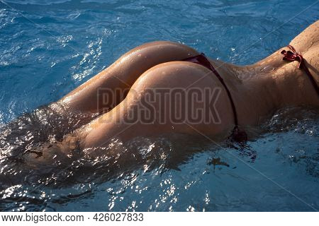 Sexy Curves Girl Butt In Bikini In Pool. Sexy Buttocks. Young Woman Shows A Beautiful Ass Buttocks I