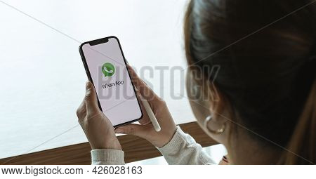 Chiangmai, Thailand - July 3, 2021 : Female Hand Holding Whatsapp Mobile Application On Apple Iphone