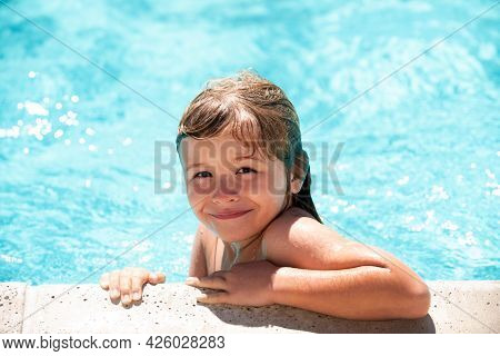 Child Relax In Summer Swimming Pool. Little Boy Playing In Outdoor Swimming Pool In Water On Summer