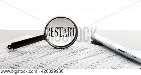 Magnifying Glass With Text Restart On Background With Pen