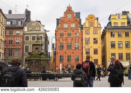 Stockholm, Sweden September 24, 2017: Tourists Take Pictures Of Colorful Houses On Stortorget Square