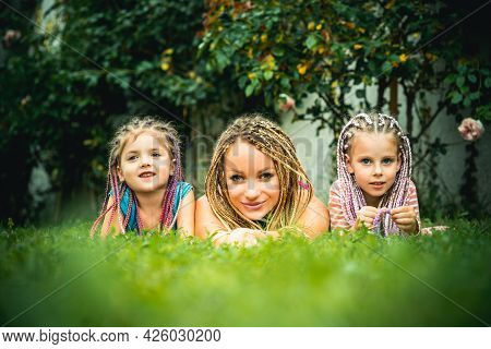 Family Outdoor Leisure. Mother And Children At Backyard. Picnic. Happy Summer Family At Garden. Back