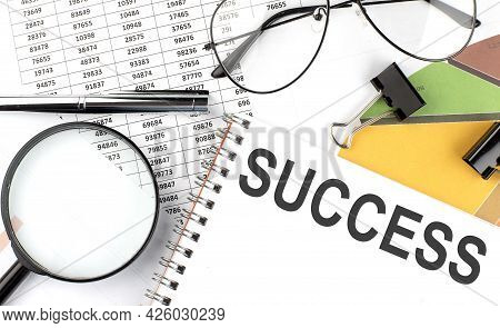 Success - The Inscription Of Text On The Notepad, And Chart. Business