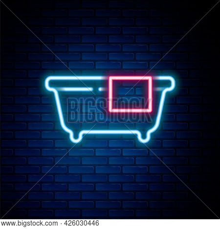 Glowing Neon Line Bathtub Icon Isolated On Brick Wall Background. Colorful Outline Concept. Vector