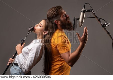 Guy And Lady With Excited Faces Enjoy Music. Karaoke Singer Couple. Man And Woman Singing With Music