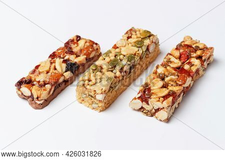 Three Protein Bars With Cereals Isolated On White Background Close-up.