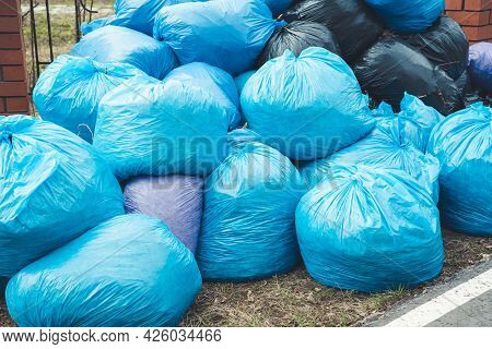 A Large Mountain Of Blue Trash Bags Piled Up After Volunteers Cleaned The Park On Saturday