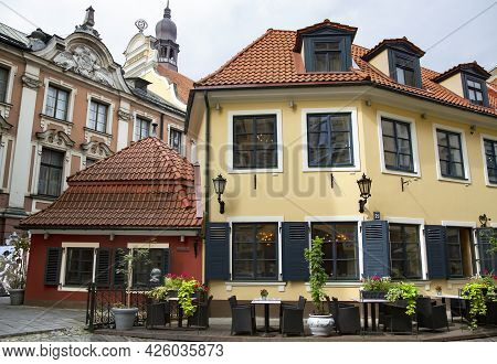 Latvia, Riga, March, 2021 - Ancient Gothic Architecture And Summer Terrace Of The Restaurant In Riga