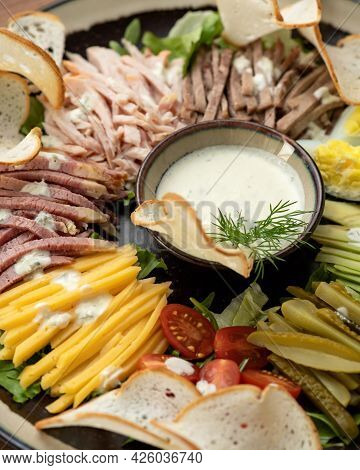 Platter With Mix Or Assorted Of Meat, Ham, Cheese And Vegetables Cuts. Mayonnaise Sauce In Center Of
