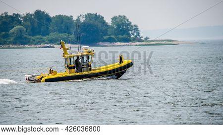 NORWALK, CT, USA - JULY 6, 2021: Towing boat service near Calf Pasture beach