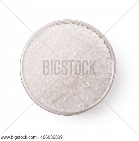 Top view of glass bowl of silica gel granules isolated on white