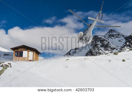 Helicopter on a ski slope in Gressoney Ski Resort, Monterosa, Italy.