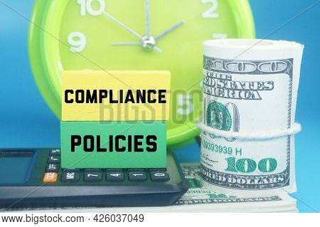 Alarm Clocks, Colored Cubes, Banknotes And The Word Compliance Policies