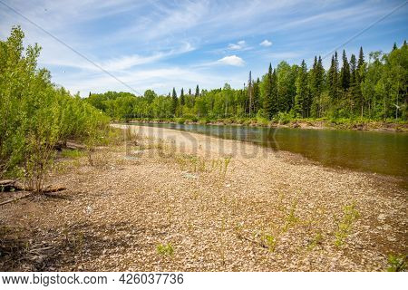 River Taidon Flowing Through The Taiga Forests, South Siberia, Russia