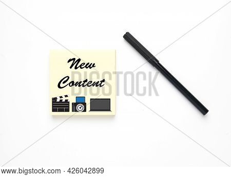 Magic Pen With Notepad Written New Content, Illustration Of Clapperboard, Camera And Laptop. Content
