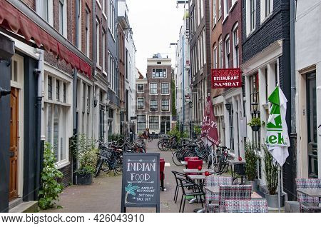 Amsterdam, Netherlands. June 06, 2021. Beautiful View Of Amsterdam With Typical Dutch Houses.