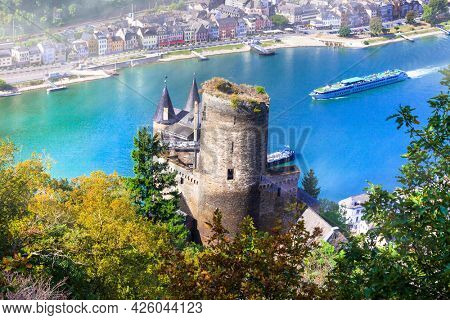 Germany tourism. German Rhine river cruises and picturesque medieval castles. Popular tourist destination and attraction. View of Sankt Goar town and Katz castle