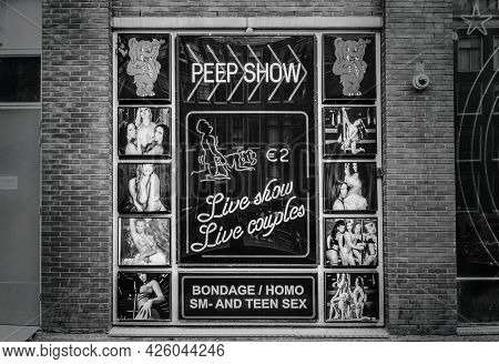 Amsterdam, Netherlands. June 06, 2021. Red Light District. Showcase With Advertising