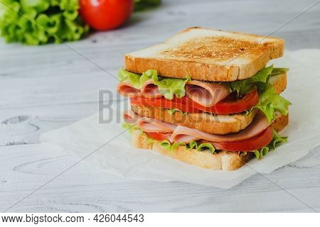 Sandwich With Ham, Green Salad And Tomato.
